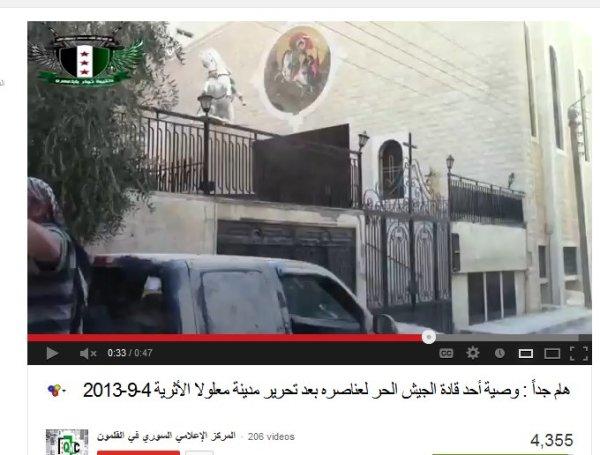 Im Hintergrund eine Kirche , davor die mörderbanden welche von Mettelsiefen in der ARD und bei CNN propagiert wurden