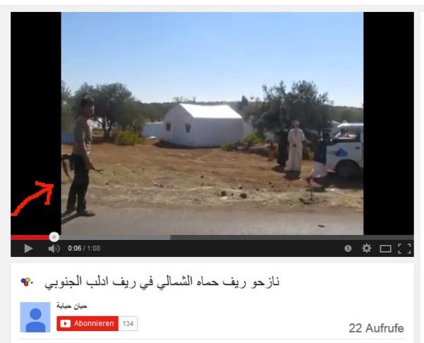 Bewaffnte und Flüchtlingscamp