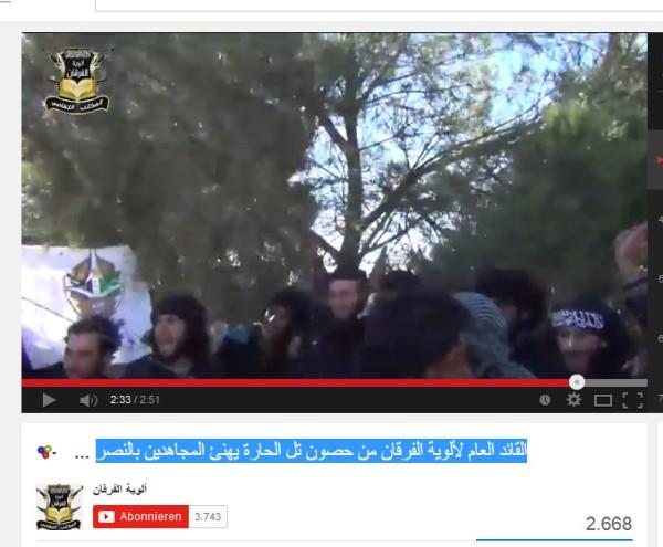 Furqan und FSA-Emblem im Hintergrund